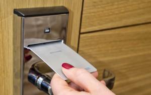 hotel-door-key-card-woman-s-hand-inserting-electronic-lock-34406936
